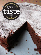 Award-winning gluten free, dairy free flourless chocolate and prune truffle cake, made with organic, gluten-free and dairy-free ingredients, and Appleton rum