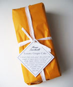 A gluten-free, dairy-free Luxury Ginger Cake, made with organic preserved ginger and sultanas, wrapped and ready for posting. This moist ginger cake is at its best a week after baking, so is perfect for posting to addresses in the UK. Delivery available in London. Gluten free and dairy free