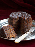 Awarded gold at the Great Taste Awards 2011, this dark, moist, silky-smooth, intensely alcoholic gluten-free, dairy-free Jamaican fruitcake is made with organic fruit, finely chopped then soaked in Appleton Jamaica Rum. Sweetened with organic blackstrap molasses, no added sugar. Gluten free, diary free. No nuts included, but not guaranteed free from nut traces. This delicious fruit cake keeps well and matures with age: perfect for sharing with friends and family. Can be posted to addresses in the UK and abroad and delivered by hand in London