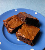 Gluten-free Cocoa Brownies: Dark, moist, sweet, and deeply chocolatey, made with organic ingredients: nutty, browned butter, Fairtrade cocoa powder, chunky walnuts, and Madagascar vanilla extract. All ingredients glutenfree
