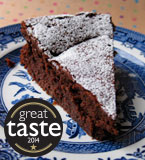 Award-winning chocolate truffle cake made with gluten free, dairy free ingredients: organic Fairtrade dark chocolate, organic extra-virgin olive oil, my own Spiced Boozy Prunes and Appleton Jamaica Rum. All ingredients gluten-free and dairy-free. This cake won a Great Taste star in 2014