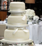 3 tier gluten free, wheat free wedding cake made with organic ingredients. Topped with marzipan and smooth ivory icing. Dairy-free wedding cakes also available