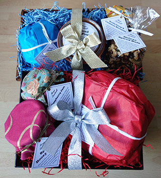 Send one of our beautiful Christmas Hampers to family or friends. Choose one of our delicious glutenfree fruitcakes, add a jar of preserves and some mince pies or spiced nuts. Delivered by post to UK and abroad, delivery by hand available in London.