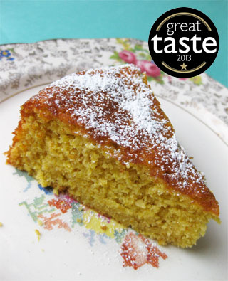 Award-winning glutenfree, dairyfree Tunisian Orange & Almond Cake. Made with organic ground almonds, oranges and extra-virgin olive oil. Comes with a sachet of organic icing sugar to dust before serving. This cake won a Great Taste award in 2013. All ingredients gluten-free and dairy-free. Can be posted in the UK, or delivered by hand in London