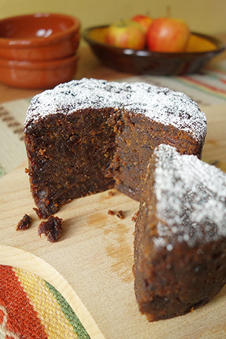 A moist, dark, vegan fruitcake made with gluten free, dairy free organic ingredients: vine fruit & citrus zests, Bramley apples and ground almonds, as well as Appleton Jamaica Rum. Lightly sweetened with organic dates, no added sugar. Comes with organic icing sugar to sprinkle before serving. All ingredients gluten-free and dairy-free