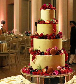 For an Indian wedding at the Banqueting House, a 4-tier glutenfree, wheatfree wedding cake. Two tiers of vanilla & raspberry and two of chocolate & almond with rum. Dairy free and vegan wedding cakes also available
